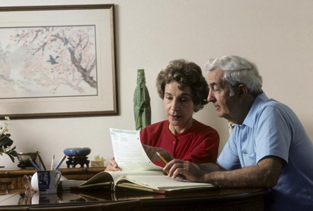 Elderly Couple Discussing Reverse Mortgages in Los Angeles, CA